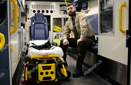 Paul Mitchell Boston Emergency Medical Services EMT Paul Mitchell sits in an ambulance at his station in the Hyde Park neighborhood of Boston. Mitchell, with bystander Carlos Arredondo and volunteer Devin Wang, are credited with helping to save the life of Jeff Bauman, who suffered traumatic injuries in the Boston Marathon bombings