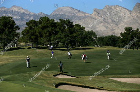 Ryan Palmer, Greg Chalmers, James Hahn Ryan Palmer, center, Greg Chalmers and James Hahn make their way down the first fairway in the first round of the Shriners Hospitals for Children Open golf tournament, in Las Vegas