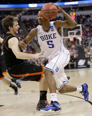 Duke forward Rodney Hood (5) runs into Mercer forward Bud Thomas (5) during the first half of an NCAA college basketball second-round game, in Raleigh, N.C
