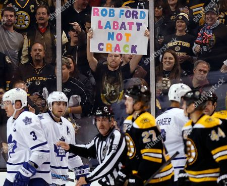 Stock Image of A fan holds a sign in reference to Toronto Mayor Rob Ford in the third period of an NHL hockey game between the Boston Bruins and the Toronto Maple Leafs in Boston, . The Bruins won 3-1