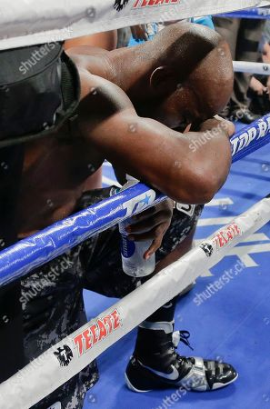 Juan Manuel Marquez, Timothy Bradley Timothy Bradley kneels and bows his head on the ropes after defeating Juan Manuel Marquez by split decision during a WBO welterweight title fight, in Las Vegas
