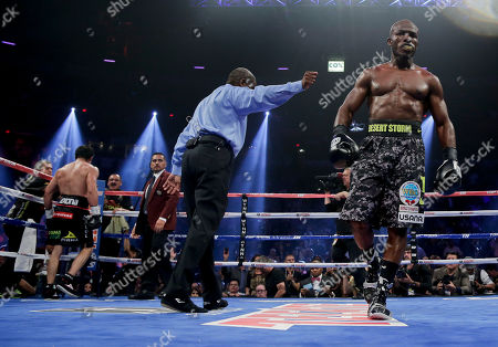 Juan Manuel Marquez, Timothy Bradley Referee Robert Byrd, center, directs Timothy Bradley, right, to his corner at the end of the fifth round against Juan Manuel Marquez during a WBO welterweight title fight, in Las Vegas. Bradley won by split decision