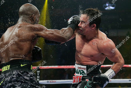 Juan Manuel Marquez, Timothy Bradley Timothy Bradley, left, exchanges punches with Juan Manuel Marquez in the sixth round during a WBO welterweight title fight, in Las Vegas. Bradley won by split decision