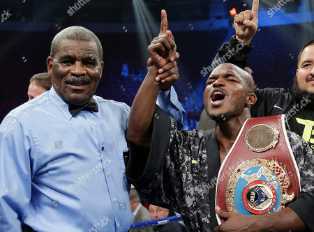 Juan Manuel Marquez, Timothy Bradley Timothy Bradley shouts to fans as he poses for photos with the title belt and referee Robert Byrd after defeating Juan Manuel Marquez during a WBO welterweight title fight, in Las Vegas. Bradley won by split decision