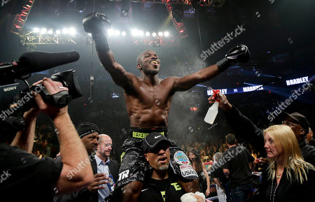 Juan Manuel Marquez, Timothy Bradley Timothy Bradley celebrates after defeating Juan Manuel Marquez by split decision during a WBO welterweight title fight, in Las Vegas