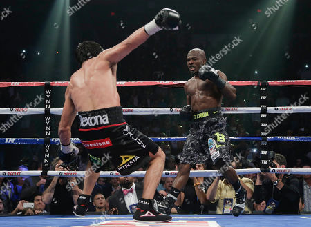 Juan Manuel Marquez, Timothy Bradley Juan Manuel Marquez, left, stumbles backward after taking a punch from Timothy Bradley in the 12th round during a WBO welterweight title fight, in Las Vegas. Bradley won by split decision