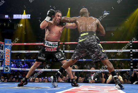 Juan Manuel Marquez, Timothy Bradley Juan Manuel Marquez, left, and Timothy Bradley exchange punches in the 9th round during a WBO welterweight title fight, in Las Vegas. Bradley won by split decision