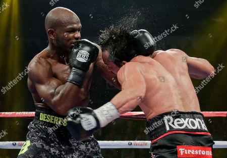 Juan Manuel Marquez, Timothy Bradley Timothy Bradley, left, lands a punch against Juan Manuel Marquez in the 11th round during a WBO welterweight title fight, in Las Vegas. Bradley won by split decision