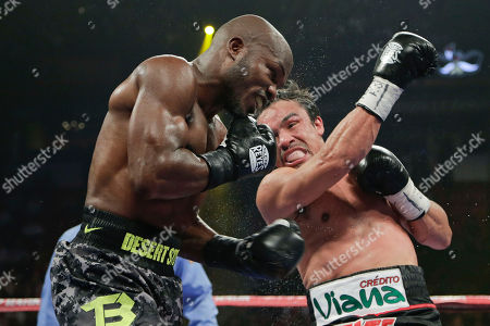 Juan Manuel Marquez, Timothy Bradley Juan Manuel Marquez, right, throws a left hook at Timothy Bradley in the seventh round. during a WBO welterweight title fight, in Las Vegas. Bradley won by split decision