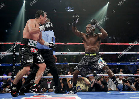 Juan Manuel Marquez, Timothy Bradley Timothy Bradley, right, holds his hands up as time winds down in the 12th round against Juan Manuel Marquez during a WBO welterweight title fight, in Las Vegas. Bradley won by split decision