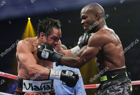 Juan Manuel Marquez, Timothy Bradley Timothy Bradley, right, lands a punch against Juan Manuel Marquez in the 11th round during a WBO welterweight title fight, in Las Vegas. Bradley won by split decision