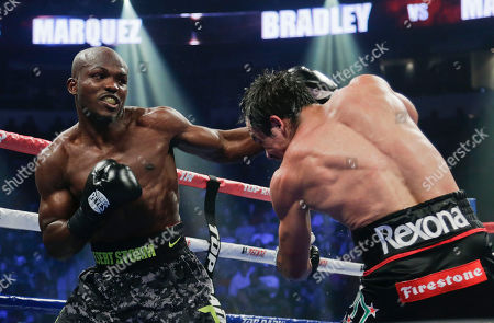 Stock Image of Juan Manuel Marquez, Timothy Bradley Timothy Bradley, left, lands a punch against Juan Manuel Marquez in the ninth round during a WBO welterweight title fight, in Las Vegas. Bradley won by split decision