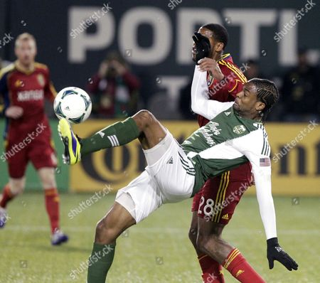Frederic Piquionne, Chris Schuler Portland Timbers forward Frederic Piquionne right, battles for the ball with Real Salt Lake defender Chris Schuler in the first half of the second game of the Western Conference finals in the MLS Cup soccer playoffs, in Portland, Ore