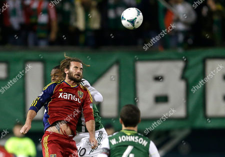 Kyle Beckerman Real Salt Lake's Kyle Beckerman, left, goes up for a header with Portland Timbers' Frederic Piquionne in the first half of the second game of the Western Conference finals in the MLS Cup soccer playoffs, in Portland, Ore