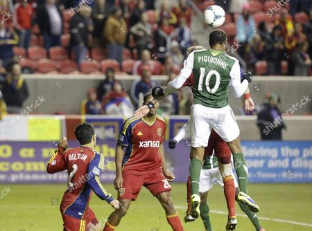 Frederic Piquionne, Tony Beltran, Chris Schuler Portland Timbers' Frederic Piquionne scores on a header as Real Salt Lake's Tony Beltran (2) and teammate Chris Schuler (28) look on in the second half half during the first leg of the MLS Western Conference final, in Sandy, Utah. Real Salt Lake won 4-2
