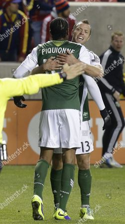 Frederic Piquionne, Jack Jewsbury Portland Timbers' Frederic Piquionne receives a hug from teammate Jack Jewsbury, right, after scoring against Real Salt Lake in the second half half during the first leg of the MLS Western Conference final, in Sandy, Utah. Real Salt Lake won 4-2