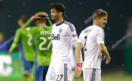 Jun Marques Davidson Vancouver Whitecaps' Jun Marques Davidson, second from right, celebrates a goal scored by Whitecaps' Nigel Reo-Coker (not shown) with teammate Jordan Harvey, right, as Seattle Sounders' Lamar Neagle (27) reacts in the background, in the second half of an MLS soccer match, in Seattle. The Whitecaps beat the Sounders, 4-1