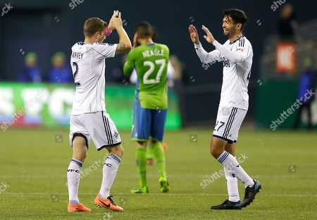 Jun Marques Davidson Vancouver Whitecaps' Jun Marques Davidson, right, celebrates a goal scored by Whitecaps' Nigel Reo-Coker (not shown) with teammate Jordan Harvey, left, as Seattle Sounders' Lamar Neagle (27) reacts in the background, in the second half of an MLS soccer match, in Seattle. The Whitecaps beat the Sounders, 4-1