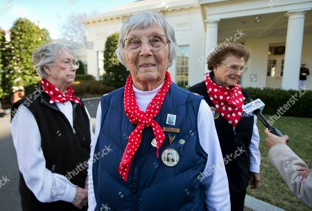 """Agnes Moore, Mary Ann Sousa, Phyllis Gould Rosie the Riveter"""" Phyllis Gould, 92, center, her sister Mary Ann Sousa, left, and Agnes Moore, 94, walk on the White House grounds in Washington, . Phyllis Gould and Agnes Moore were both welders and Mary Ann Sousa was a draftsman at Kaiser Shipyard in Richmond, Calif., during the war. Rosie the Riveter are American women who took the job of American men who were in the military during World War II, working in factories"""