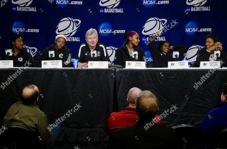 Stock Image of Kristen Grant, Courtney Walker, Gary Blair, Karla Gilbert, Jordan Jones, Courtney Williams From left to right, Texas A&M players Kristen Grant, Courtney Walker, coach Gary Blair, Karla Gilbert, Jordan Jones and Courtney Williams participate, in a news conference ahead of a regional finals game in the NCAA college basketball tournament in Lincoln, Neb. Texas A&M will play Connecticut in the finals on Monday