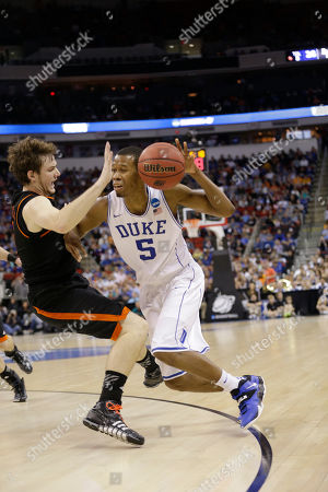 Stock Photo of Duke forward Rodney Hood (5) runs into Mercer forward Bud Thomas (5) during the first half of an NCAA college basketball second-round game, in Raleigh, N.C