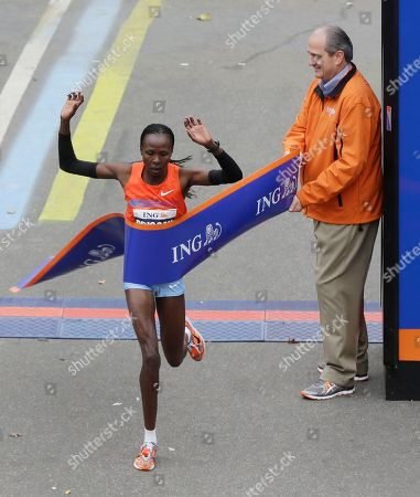 Priscah Jeptoo Priscah Jeptoo of Kenya crosses the finish line first in the women's division, past Rodney Martin, CEO of ING U.S. Inc., at the 2013 New York City Marathon in New York