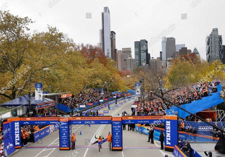 Priscah Jeptoo Priscah Jeptoo of Kenya, center, crosses the finish line first in the women's division at the 2013 New York City Marathon in New York