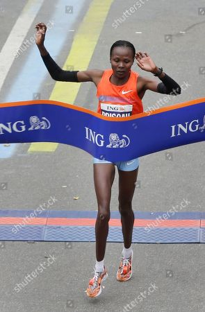Priscah Jeptoo Priscah Jeptoo of Kenya crosses the finish line first in the women's division at the 2013 New York City Marathon in New York
