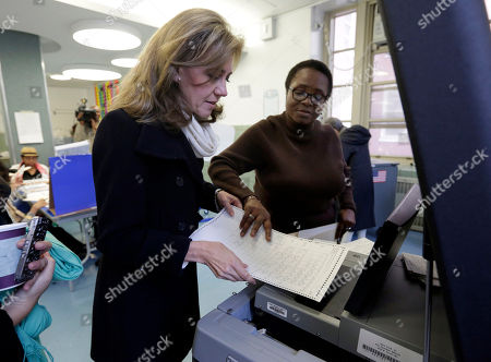 Silda Wall, Edith Maduakolam Silda Wall, wife of former New York Gov. Eliot Spitzer, who was also recently a candidate for New York City comptroller, has her ballot scanned by Edith Maduakolam at Public School 6, in New York, . The casting of ballots Tuesday signals the beginning of New York City's farewell to Mayor Michael Bloomberg, who has helped shape the nation's biggest city for 12 years, largely setting aside partisan politics as he led with data-driven beliefs and his vast fortune
