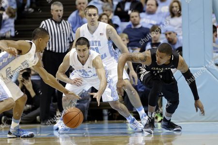 Duke Mondy, J.P. Tokoto, Luke Davis North Carolina's J.P. Tokoto, left, and Luke Davis struggle for possession of the ball with Oakland's Duke Mondy, right, during the second half of an NCAA college basketball game in Chapel Hill, N.C., . North Carolina won 84-61