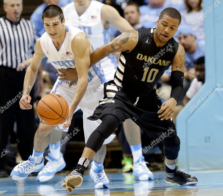 Luke Davis, Duke Mondy North Carolina's Luke Davis, left, and Oakland's Duke Mondy (10) reach for a loose ball during the second half of an NCAA college basketball game in Chapel Hill, N.C., . North Carolina won 84-61