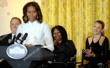 Stock Image of Michelle Obama, Harvey Weinstein, Whoopie Goldberg, Blake Lively Movie mogul Harvey Weinstein, left, Oscar-winning actress Whoopie Goldberg, second from right, and actress Blake Lively, right, listen to first lady Michelle Obama, second from left, as she speaks in the East Room of the White House in Washington, at a workshop for high school students from Washington, New York and Boston about careers in film