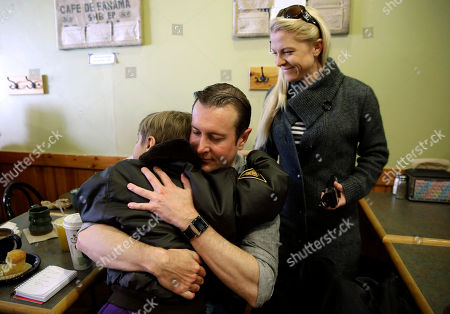 Kurt Busch, Patricia Driscoll, Houston Driscoll On, with his girlfriend Patricia Driscoll looking, Kurt Busch, center, hugs Driscoll's son Houston goodbye at a coffee shop in Ellicott City, Md. On Memorial Day weekend, NASCAR's bad boy is trying to own the title of baddest man on the track by pulling off racing's version of an IronMan triathlon. In a single day, he'll try and race in the Indianapolis 500 and the Coca-Cola 600, with a race or two against the clock thrown in