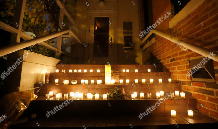 Candles sit on the steps of Chicago chef Charlie Trotter's former restaurant after friends and former employees of Trotter's placed them there after a candlelight tribute to Trotter, in Chicago. Trotter, 54, died Tuesday, a year after closing his namesake Chicago restaurant that was credited with putting his city at the vanguard of the food world and training dozens of the nation's top chefs, including Grant Achatz and Graham Elliot
