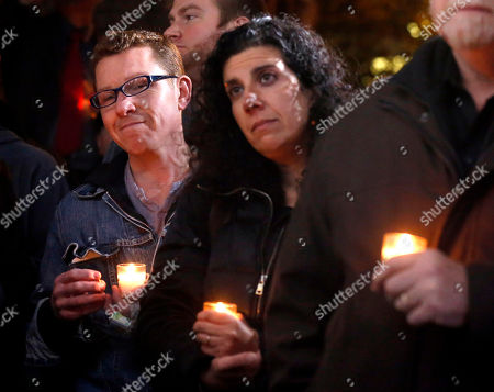 Friends and former employees of Chicago Chef Charlie Trotter gather outside Trotter's former restaurant for a candlelight tribute, in Chicago. Trotter, 54, died Tuesday, a year after closing his namesake Chicago restaurant that was credited with putting his city at the vanguard of the food world and training dozens of the nation's top chefs, including Grant Achatz and Graham Elliot