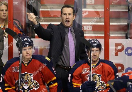 Kevin Dineen, Aleksander Barkov, Brad Boyes Florida Panthers head coach Kevin Dineen calls out to players during the first period of an NHL hockey game against the Los Angeles Kings, in Sunrise, Fla. Looking on are center Aleksander Barkov (16) of Finland, and center Brad Boyes (24). Dineen has been fired as coach of the Panthers. The team made the announcement, one day after their losing streak reached seven with a 4-1 loss at Boston. Also fired were assistants Gord Murphy and Craig Ramsay. Peter Horachek is the Panthers' interim head coach