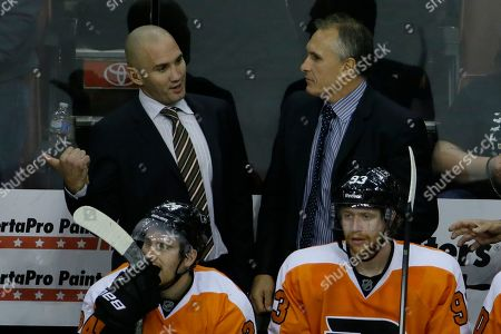 Craig Berube, Ian Laperriere Philadelphia Flyers head coach Craig Berube, right, talks with assistant coach Ian Laperriere during an NHL hockey game against the Florida Panthers, in Philadelphia
