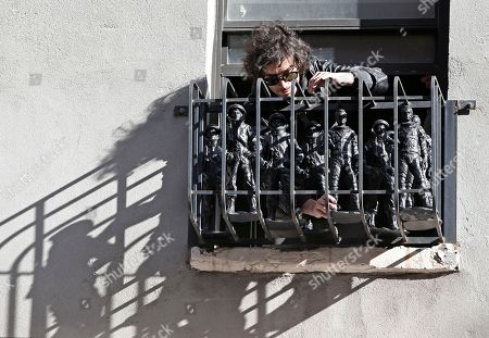 Fabrizio Moretti This photo shows The Strokes' drummer Fabrizio Moretti arranging cast-in-plastic astronauts on the fire escape of an second story apartment above his public art installation outside the SoHo Rag & Bone store in New York. The installation is part of the clothing brand's ongoing urban art project, in which artists revamp the store's façade. But for Moretti, it's a chance to revisit his long latent background