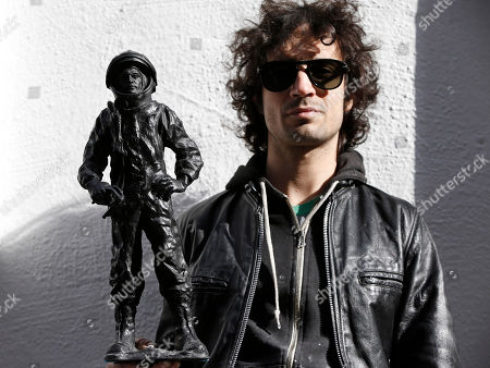 Fabrizio Moretti This photo shows The Strokes' drummer Fabrizio Moretti with one of his cast-in-plastic astronauts beside the SoHo Rag & Bone store where his art installation in New York. Moretti's installation at one time included white niches filled with white plastic astronauts, but they were all stolen. Moretti created new black astronauts but relocated the new pieces to a second-story fire escape above the installation
