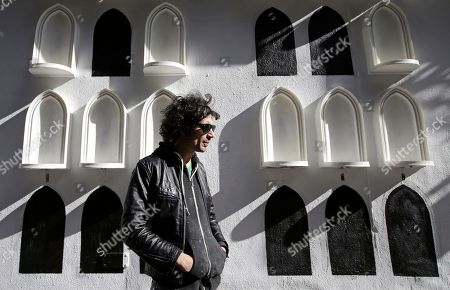 Fabrizio Moretti This photo shows The Strokes' drummer Fabrizio Moretti in front of his installation on the exterior wall of the SoHo Rag & Bone store in New York. The installation is part of the clothing brand's ongoing urban art project, in which they get artists to revamp the store's façade
