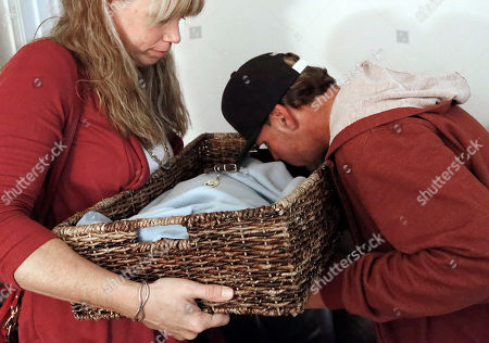 Mary Gardner, Mike Kelley On, veterinarian Dr. Mary Gardner holds Mike Kelley's euthanized cat, Andy, in a special basket as Kelley gives it a kiss at his home in Newport Beach, Calif. A few weeks earlier, 10-year-old Andy didn't greet Kelley at the door as usual and was soon diagnosed with liver disease, which meant euthanasia. It happened with the help of Gardner, co-founder of Lap of Love Veterinary Hospice, the country's first organized network of veterinarians who provide hospice and end of life care in the pet's home