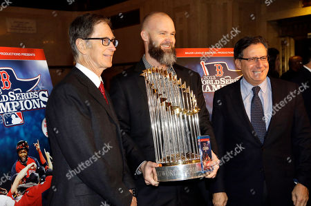 John Henry, David Ross, Thomas Werner Boston Red Sox owner John Henry, left, catcher David Ross, center, and Chairman Thomas Werner, right, stand with the 2013 World Series baseball trophy on the red carpet at the Wang Theatre before a screening of a DVD about the series, in Boston