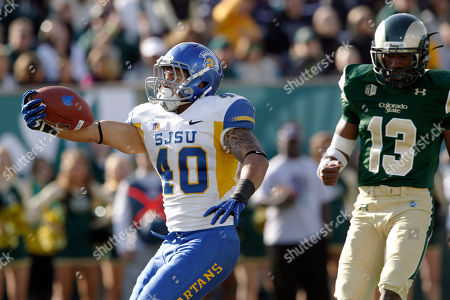 Jarrod Lawson, DeAndre Elliott San Jose State running back Jarrod Lawson, left, celebrates his touchdown run as Colorado State defensive back DeAndre Elliott looks on in the third quarter of San Jose State's 34-27 victory in an NCAA college football game in Fort Collins, Colo., on