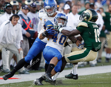 Billy Freeman, Jarrod Lawson, Tyree Simmons San Jose State running back Jarrod Lawson, center, is dragged down by Colorado State defensive back Tyree Simmons, right, as San Jose State tight end Billy Freeman, left, gets tangled up in the play in the fourth quarter of San Jose State's 34-27 victory in an NCAA college football game in Fort Collins, Colo., on