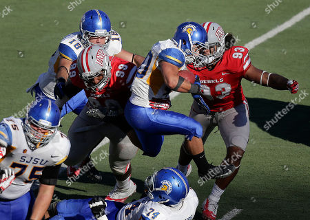 Stock Picture of Jarrod Lawson, Ryan Jones San Jose State running back Jarrod Lawson (40) leaps over guard Ryan Jones (74) on his way to a first down against UNLV in the third quarter of an NCAA college football game, in Las Vegas. San Jose State won 34-24