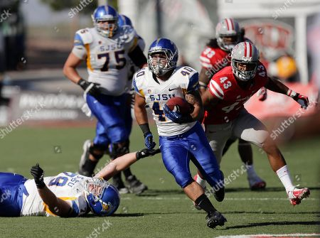 San Jose State running back Jarrod Lawson (40) runs the ball for a first down against UNLV in the second quarter of an NCAA college football game, in Las Vegas