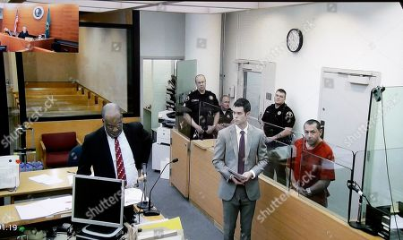 Stock Image of Michael Sean Stanley, Karen Donohue In this image photographed from a video monitor, Michael Sean Stanley, right, appears in court with defense attorney Nick Gross as Seattle Assistant City Attorney John McGoodwin, left, reads charges, in Seattle. Judge Karen Donohue is seen via another camera in the upper-left corner. Days after Canadian authorities decided not to extradite Stanley, a violent sex offender who crossed into the U.S., he is in custody, suspected of sexually assaulting a 16-year-old boy. Stanley appeared in a Seattle court on Wednesday after being jailed for investigation of harassment for an incident Tuesday morning. Seattle Municipal Court Judge Karen Donohue set his bail at $100,000, citing the circumstances of how Stanley left Canada