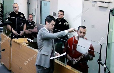 Stock Photo of Michael Sean Stanley In this image photographed off of a video monitor, Michael Sean Stanley, right, appears in court with defense attorney Nick Gross as sheriff's deputies look, in Seattle. Days after Canadian authorities decided not to extradite Stanley, a violent sex offender who crossed into the U.S., he is in custody, suspected of sexually assaulting a 16-year-old boy. Stanley appeared in a Seattle court on Wednesday after being jailed for investigation of harassment for an incident Tuesday morning