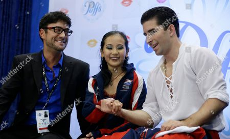 Felicia Zhang, Nathan Bartholomay, James Paterson From left, coach James Peterson, Felicia Zhang and Nathan Bartholomay celebrate after the pairs free skating routine at the Skate America figure skating competition in Detroit