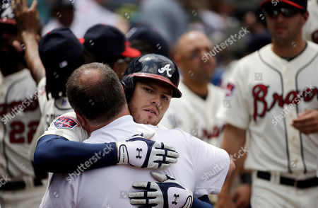 Freddie Freeman, Jim Lovell Atlanta Braves' Freddie Freeman, right, embraces trainer Jim Lovell after hitting a two-run home run in the second inning of a baseball game against the Washington Nationals, in Atlanta